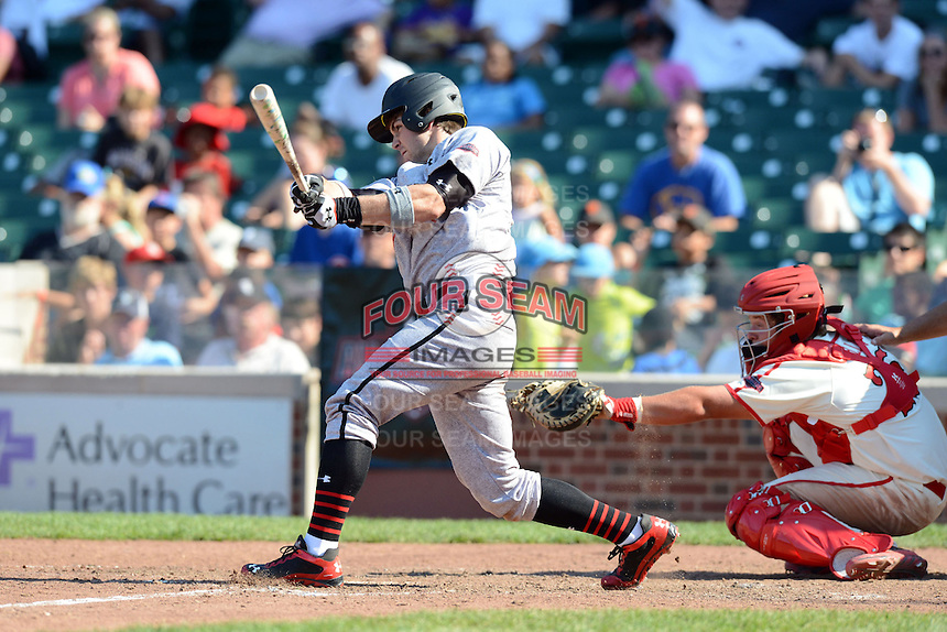 Outfielder Michael Gettys (33) of Gainesville High School in Gainesville, Florida at bat in front of catcher Chase Vallot during the Under Armour All-American Game on August 24, 2013 at Wrigley Field in Chicago, Illinois.  (Mike Janes/Four Seam Images)