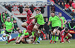 Munster flanker Dave O'Callaghan bursts through the middle of the Scarlets defence.<br /> Guiness Pro12<br /> Scarlets v Munster<br /> 21.02.15<br /> ©Steve Pope -SPORTINGWALES