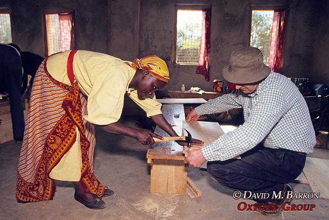 Kenyan Woman & Barrie Callow Building Solar Oven