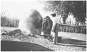 Mr. Dozier and an Indian woman at a Santa Clara Pueblo horno.<br /> Santa Clara Pueblo, NM