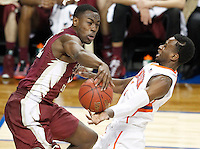 Florida State's Montay Brandon (32) blocks a layup attempt by Clemson's Austin Ajukwa (1) on a fast break in the first half of Wednesday's second-round game of the ACC Tournament in Greensboro, N.C. Clemson lost 76-73.