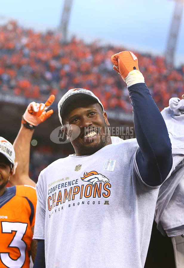 Jan 24, 2016; Denver, CO, USA; Denver Broncos linebacker Von Miller celebrates on the podium after defeating the New England Patriots in the AFC Championship football game at Sports Authority Field at Mile High. The Broncos defeated the Patriots 20-18 to advance to the Super Bowl. Mandatory Credit: Mark J. Rebilas-USA TODAY Sports
