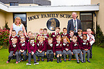 Holy Family School Tralee junior infants on their first day at school on Monday with Mrs Moriarty and Principal Ed O'Brien