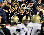 United States President Barack Obama departs the 112th meeting of the United States Army Black Knights and the U.S. Navy Midshipmen at FedEx Field in Landover, Maryland on Saturday, December 10, 2011.  Lieutenant General David H. Huntoon, Jr., Director of the Army Staff, U.S. Army, is at left. Navy won the game 27 - 21..Credit: Ron Sachs / CNP
