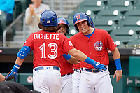 Buffalo Bisons Andy Burns (right) congratulates Bo Bichette (13) after hitting a home run during an International League game against the Indianapolis Indians on June 20, 2019 at Sahlen Field in Buffalo, New York.  Buffalo defeated Indianapolis 11-8  (Mike Janes/Four Seam Images)