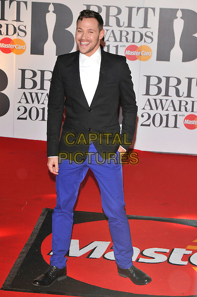 WILL YOUNG .The BRIT Awards 2011 - Arrivals at the O2 Arena, London, England, UK, .February 15th, 2011..brits full length black jacket white shirt blue trousers .CAP/PL.©Phil Loftus/Capital Pictures.