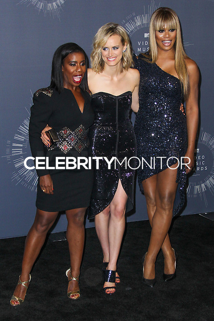 INGLEWOOD, CA, USA - AUGUST 24: Actresses Uzo Aduba, Taylor Schilling and Laverne Cox pose in the press room at the 2014 MTV Video Music Awards held at The Forum on August 24, 2014 in the Inglewood, California, United States. (Photo by Xavier Collin/Celebrity Monitor)
