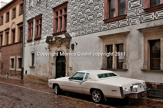 An old car parked on Kanonicza Street that leads to Wawel Castle in Krakow, Poland