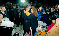 Ann Arbor, Michigan, USA, October 19, 1992<br /> Presidential candidate Governor William Clinton arrives at the University of Michigan at Ann Arbor for the final debate with the incumbent President George H.W. Bush  and pauses to hold another baby. Credit: Mark Reinstein/MediaPunch