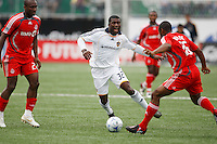 Los Angeles Galaxy midfielder Brandon McDonald (32) is defended by Toronto FC defender Marvell Wynne (16). Toronto FC defeated the Los Angeles Galaxy 2-0 during a Major League Soccer match at BMO Field in Toronto, Ontario, Canada, on May 31, 2008.