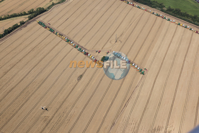 Combines 4 Charity is an initiative created by a group of cereal farmers in the North East of Ireland to set a Guinness world record by having the most combine harvesters working simultaneously in one field...Pictures from the record breaking harvesting at Platin..Photo: Fran Caffrey/www.newsfile.ie...