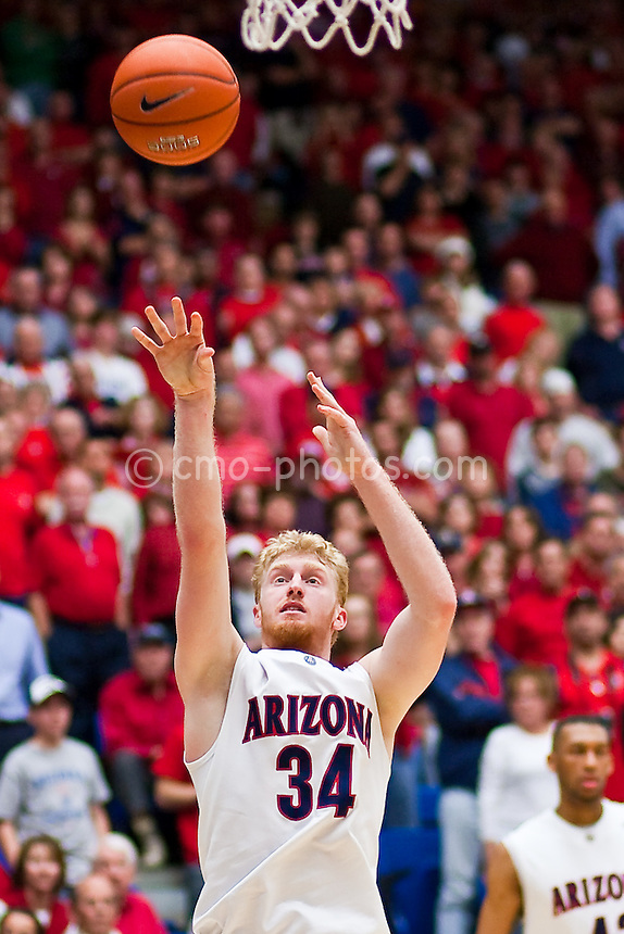 Feb 14, 2009; Tucson, AZ, USA; Arizona Wildcats forward Chase Budinger (34) shoots the ball in the second half of a game against the UCLA Bruins at the McKale Center.   The Wildcats won the game 84-72 to break an eight-game losing streak against the Bruins and win their seventh game in a row.