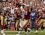 San Francisco 49ers wide receiver J.J. Stokes (83) and tackle Scott Gragg (78) celebrate with wide receiver Terrell Owens (81) on his touchdown on Sunday, September 15, 2002, in San Francisco, California. The Broncos defeated the 49ers 24-14. .