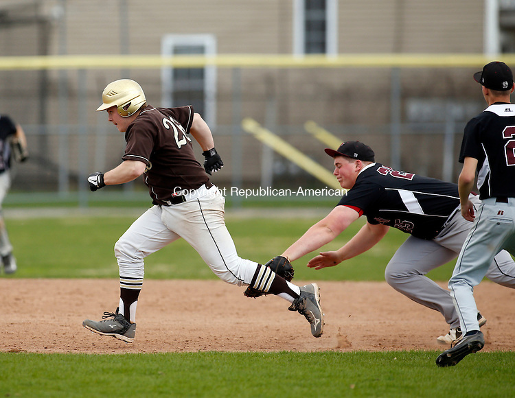 Torrington, CT- 02 May 2015-050215CM06-  Thomaston's Tyler D'Onofrio is tagged out by Torrington first baseman, Ben Bonvicini after being caught in a rundown during their baseball matchup in Torrington on Saturday.  Torrington would go onto win, 12-8.    Christopher Massa Republican-American