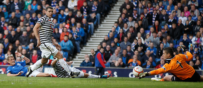 Dean Shiels sees a goalbound shot stopped by the glove of keeper Neil Parry
