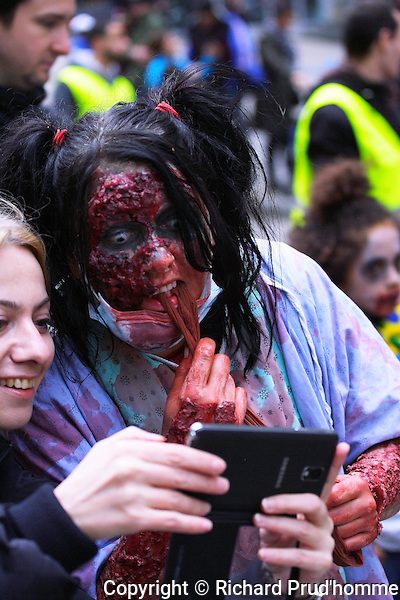 A female zombie stops to take a selfie with another young women