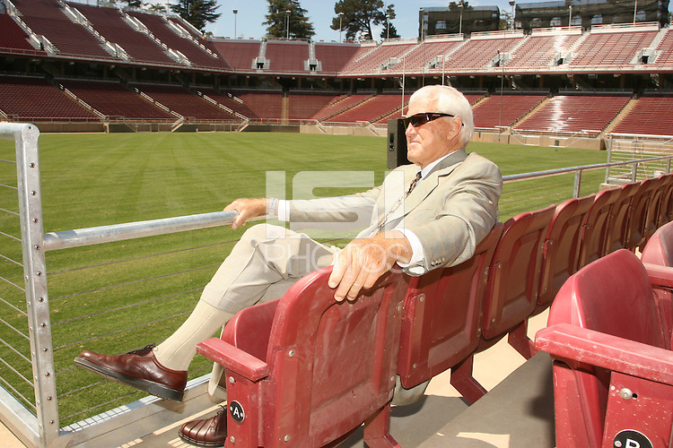 22 August 2006: Members of the media gather at a press conference at the new Stanford Stadium in Stanford, CA to introduce new concessions menus and provide a sneak peak at the venue. Bill Walsh relaxes in a seat.