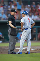 Stockton Ports manager Rick Magnante (7) discusses a call with home plate umpire Brian Walsh during the game against the Inland Empire 66ers at San Manuel Stadium on July 6, 2017 in San Bernardino, California. The Ports defeated the 66ers 7-6.  (Brian Westerholt/Four Seam Images)