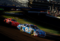 Nov 13, 2005; Phoenix, Ariz, USA;  Nascar Nextel Cup driver Kyle Petty driver of the #45 Georgia-Pacific Dodge leads Jeff Burton during the Checker Auto Parts 500 at Phoenix International Raceway. Mandatory Credit: Photo By Mark J. Rebilas