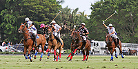 WELLINGTON, FL - APRIL 25:  Polito Pieres of Orchard Hill  (pink helmet) controls the ball down the field. Valiente defeats Orchard Hill 13-12, in OT,  in the US Open Polo Championship Final, to win the U. S. Polo Triple Crown, at the International Polo Club Palm Beach, on April 25, 2017 in Wellington, Florida. (Photo by Liz Lamont/Eclipse Sportswire/Getty Images)