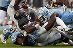 12 September 2015: NC A&T's Tony McRae (center) is tackled by UNC's Damien Washington (35) and Andre Smith (56) after running back the opening kickoff. The University of North Carolina Tar Heels hosted the North Carolina A&T State University Aggies at Kenan Memorial Stadium in Chapel Hill, North Carolina in a 2015 NCAA Division I College Football game.