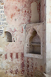 Building interior details medieval piscina for holy water, small aumbry niche hole, layers of paint on painted wall, church architectural features, Inglesham, Wiltshire, England