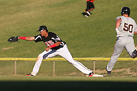 Ronald Guzman (31) of the High Desert Mavericks catches a throw to first base ahead of Tyler Horan (50) of the San Jose Giants to record a out during a game at Mavericks Stadium on June 14, 2015 in Adelanto, California. High Desert defeated San Jose, 7-5. (Larry Goren/Four Seam Images)