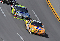 Apr 26, 2009; Talladega, AL, USA; NASCAR Sprint Cup Series driver Kyle Busch (18) leads Jimmie Johnson (48) during the Aarons 499 at Talladega Superspeedway. Mandatory Credit: Mark J. Rebilas-