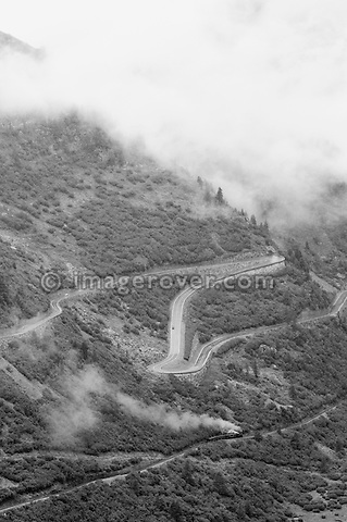 Switzerland, Western Europe, Grimsel-/Furka region, Furkapass nr. Gletsch. South-western descent of the Furka mountain road above the Furka steam railway nearing Gletsch.