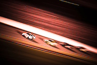Eventual winner Tony Stewart leads Kyle Busch, Denny Hamlin and Jimmie Johnson into the tri-oval..4 July, 2009, Daytona Beach, Florida USA..©2009 F.Peirce Williams, USA.