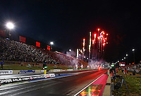 Jul. 18, 2014; Morrison, CO, USA; Fireworks explode following the conclusion of NHRA qualifying for the Mile High Nationals at Bandimere Speedway. Mandatory Credit: Mark J. Rebilas-