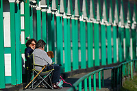 WEATHER PICTURE WALES<br /> A couple of ladies enjoy the sun during the unusually warm weather in Langland Bay near Swansea, Wales, UK. Wednesday 27 February 2019
