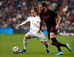 Real Madrid CF's Luka Modric and Sevilla FC's Nemanja Gudelj competes for the ball during the Spanish La Liga match round 20 between Real Madrid and Granada CF at Santiago Bernabeu Stadium in Madrid, Spain