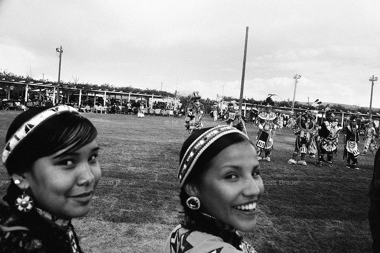 Girls  wait for a dance to begin at the Rocky Boy Powwow on the Rocky Boy Reservation in Montana.