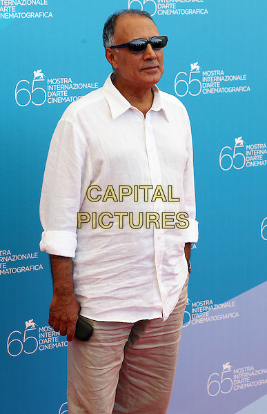 "ABBAS KIAROSTAMI, Director.""Shirin"" Photocall during the 65th Venice Film Festival, Venice, Italy..August 28th, 2008.half length brown beige trousers white shirt sunglasses shades.CAP/ADM/Liverani.©Liverani/AdMedia/Capital Pictures"