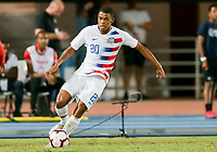 GEORGETOWN, GRAND CAYMAN, CAYMAN ISLANDS - NOVEMBER 19: Reggie Cannon #20 of the United States moves with the ball during a game between Cuba and USMNT at Truman Bodden Sports Complex on November 19, 2019 in Georgetown, Grand Cayman.