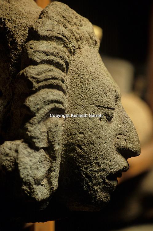 Profile of Maya Corn god stone sculpture, Maya Site, Copan, Honduras