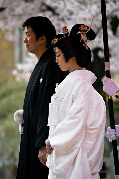 A married couple wears traditional Japanese wedding kimonos at Harimanokuni-Sosha Shrine in Japan