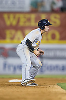 Billy Fleming (8) of the Charleston RiverDogs takes his lead off of second base against the Hickory Crawdads at L.P. Frans Stadium on August 25, 2015 in Hickory, North Carolina.  The Crawdads defeated the RiverDogs 7-4.  (Brian Westerholt/Four Seam Images)