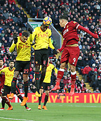 17th March 2018, Anfield, Liverpool, England; EPL Premier League football, Liverpool versus Watford; Abdoulaye Doucoure of Watford wins the ball in the air from Roberto Firmino of Liverpool