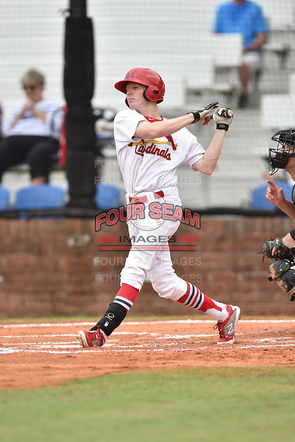 Johnson City Cardinals right fielder Blake Drake #40 swings at a pitch during a game against the Bristol Pirates at Howard Johnson Field July 20, 2014 in Johnson City, Tennessee. The Pirates defeated the Cardinals 4-3. (Tony Farlow/Four Seam Images)