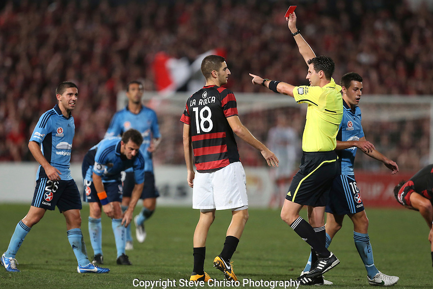 Sydney Derby - Sydney FC v Western Sydney Wanderers FC at Parramatta Stadium. Wanderers Iacopo La Rocca is sent off by referee Kris Griffiths-Jones after a tackle on Sydney's Terry Antonis.  Sydney, Australia. Saturday, March 23rd 2013. Photo; (Steve Christo).
