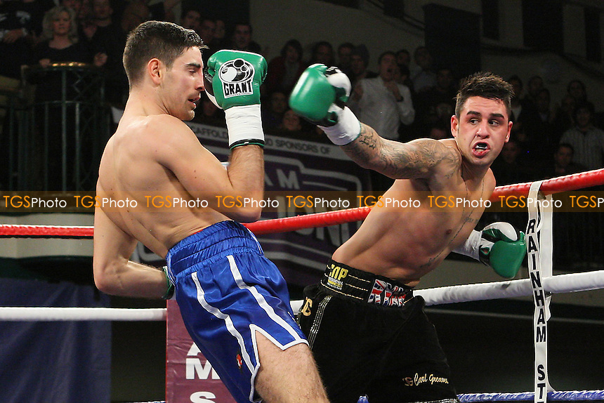 Frank Buglioni (blue shorts) defeats Ryan Clark in a Super-Middleweight boxing contest at York Hall, Bethnal Green, promoted by Frank Warren - 10/02/12 - MANDATORY CREDIT: Gavin Ellis/TGSPHOTO - Self billing applies where appropriate - 0845 094 6026 - contact@tgsphoto.co.uk - NO UNPAID USE.