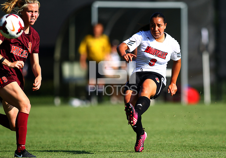 WINSTON-SALEM, NORTH CAROLINA - August 30, 2013:<br />  Charlyn Corral (9) of Louisville University fires a shot past Jordan Coburn (19) of Virginia Tech during a match at the Wake Forest Invitational tournament at Wake Forest University on August 30. The game ended in a 1-1 tie.