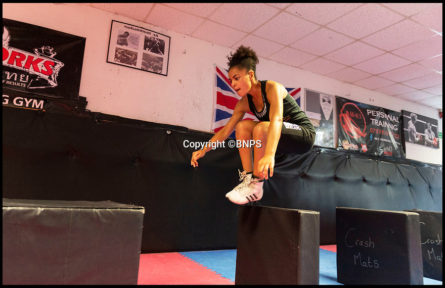 BNPS.co.uk (01202 558833)Pic: RogerArbon/BNPS<br /> Gabrielle Reid training at Primitive Gym in Poole, Dorest.<br /> <br /> An inspiring 14 year old girl with cerebral palsy who was once wheelchair bound has taken part in her boxing match - and she won.Gabrielle Reid was born with right hemiplegia which affects her muscle control and movement making it difficult to walk, let alone spar in the ring.However, since taking up boxing five years ago, her movement and coordination have improved to such an extent that she has just competed in her first bout in her home town of Poole, Dorset.She defeated a fully able bodied fighter in a three round contest and has now set her sights on her second bout, scheduled for October.