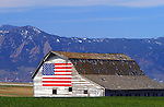 Barn in the USA<br /> Historic and patriotic gambrel style barn on Gunbarrel Hill. The city of Boulder and the famous Flatirons are in the background.<br /> Boulder County, Colorado