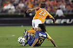 25 July 2007:  Federico Insua (8) of Club America trips up Stuart Holden (22) of the Dynamo.  Club America was defeated by the Houston Dynamo 0-1 at Robertson Stadium in Houston, Texas, in a first round SuperLiga 2007 match.