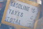 Gasoline price sign: 19 cents, taxes, 4 cents, total: 23 cents per gallon, Darwin, California.