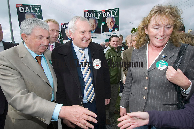 The taoiseach Bertie Ahern presses the flesh in Kilrush flanked by candidate Brendan Daly. Photograph by John Kelly.