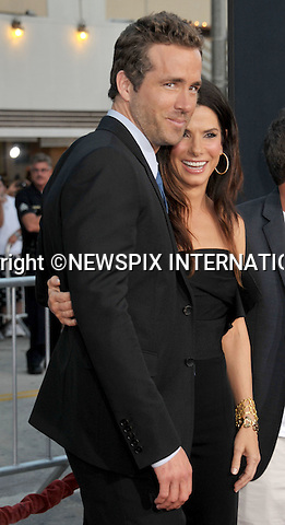 """SANDRA BULLOCK AND RYAN REYNOLDS.attends the World Premiere of """"The Change-Up"""" at the Village Theatre, Westwood, Los Angeles_01/08/2011.Mandatory Photo Credit: ©Crosby/Newspix International. .**ALL FEES PAYABLE TO: """"NEWSPIX INTERNATIONAL""""**..PHOTO CREDIT MANDATORY!!: NEWSPIX INTERNATIONAL(Failure to credit will incur a surcharge of 100% of reproduction fees).IMMEDIATE CONFIRMATION OF USAGE REQUIRED:.Newspix International, 31 Chinnery Hill, Bishop's Stortford, ENGLAND CM23 3PS.Tel:+441279 324672  ; Fax: +441279656877.Mobile:  0777568 1153.e-mail: info@newspixinternational.co.uk"""